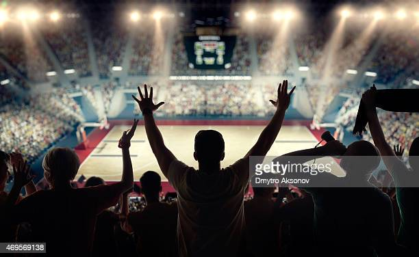 basketball fans at basketball arena - basketball sport stock pictures, royalty-free photos & images