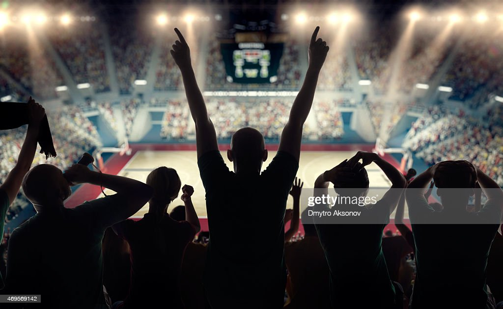 Basketball fans at basketball arena : Stock Photo