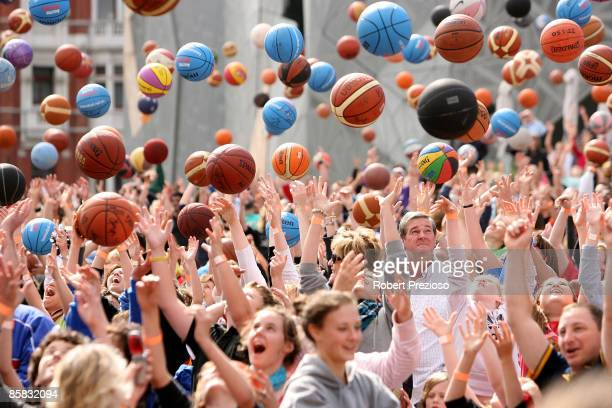 Basketball fans celebrate a world record attempt for dribbling during the Basketball Australia Brand Launch at Federation Square on April 7 2009 in...