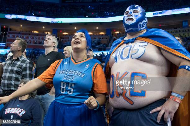 Basketball fans cheer for the Oklahoma City Thunder during the first half of a NBA game against the New York Knicks at the Chesapeake Energy Arena on...