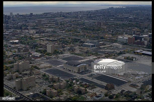 Feature Aerial view of both the old and new Chicago Stadium w city in bkgrd