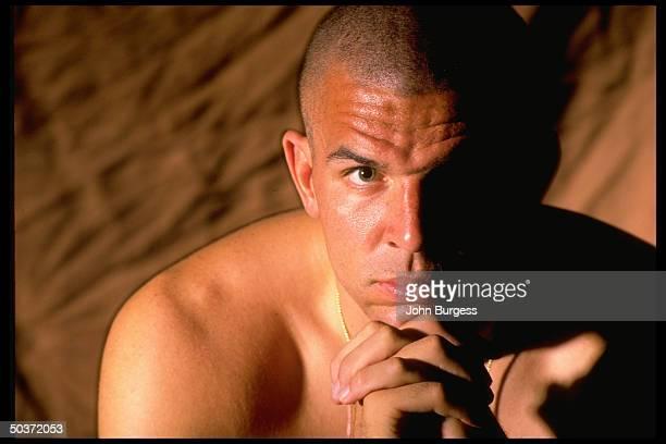 Feature Casual studio portrait of Dallas Mavericks Jason Kidd alone Half of face in shadow