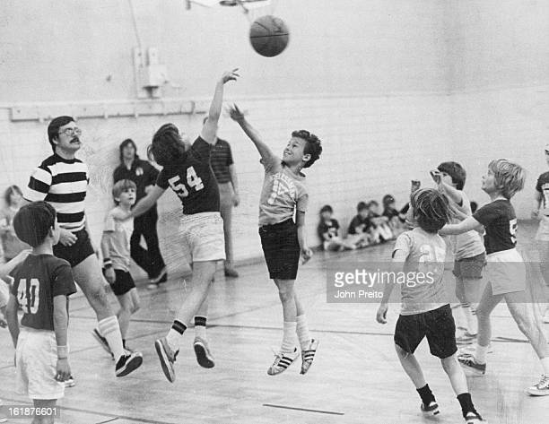 FEB 25 1974 MAR 1 1974 MAR 6 1974 Basketball fever reached a high at Schlessman YMCA when 26 teams in three boys basketball leagues competed for the...