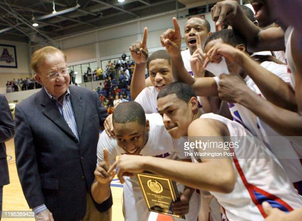Basketball Finals at Am Un DeMatha defeats Gonzaga 7152 in the boys championship game Former coach Morgan Wootten looks on as the Stags celebrate...