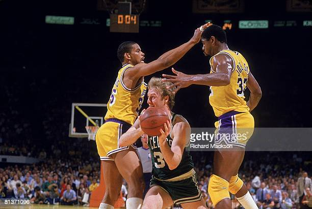 Basketball finals Boston Celtics Larry Bird in action vs Los Angeles Lakers Magic Johnson and Kevin Grevey Los Angeles CA 6/7/1985