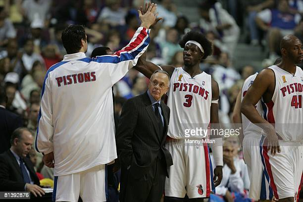 Basketball finals Detroit Pistons Mehmet Okur victorious with Ben Wallace as coach Larry Brown watches game vs Los Angeles Lakers Auburn Hills MI...