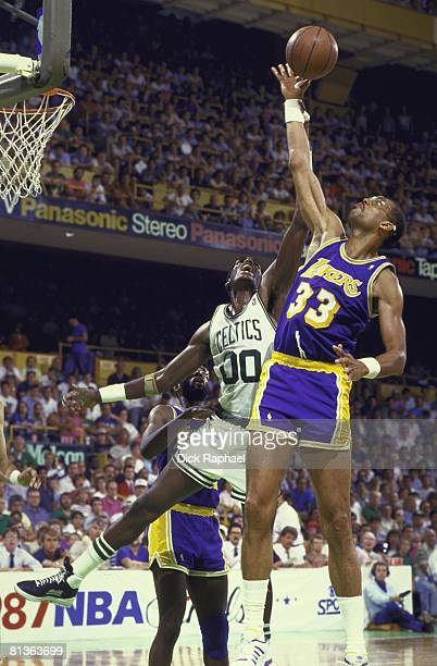 Basketball finals Los Angeles Lakers Kareem AbdulJabbar in action vs Boston Celtics Robert Parish Boston MA 6/1/1987