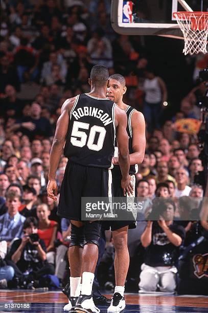 Basketball finals San Antonio Spurs David Robinson with Tim Duncan during game vs New York Knicks New York NY 6/25/1999