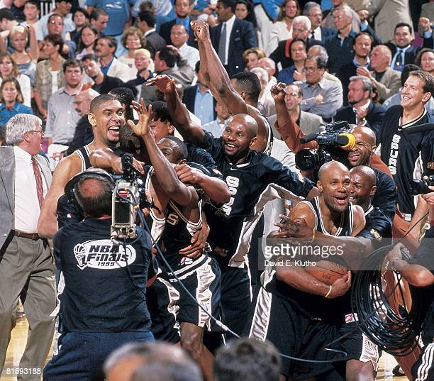Basketball finals San Antonio Spurs Mario Elie victorious with ball and Tim Duncan Avery Johnson and Jaren Jackson after winning game vs New York...