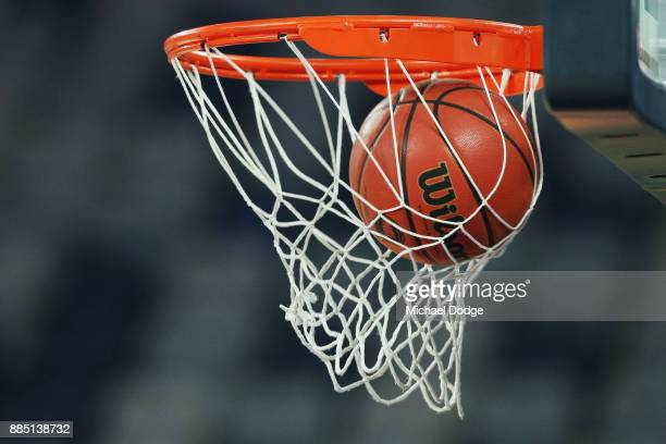 A basketball flies through the hoop during the round eight NBL match between Melbourne United and the Illawarra Hawks at Hisense Arena on December 4...