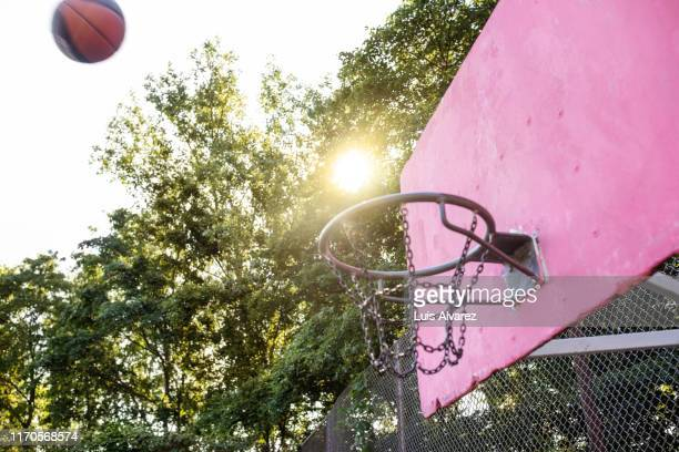 basketball flying towards the hoop - shooting at goal stock pictures, royalty-free photos & images