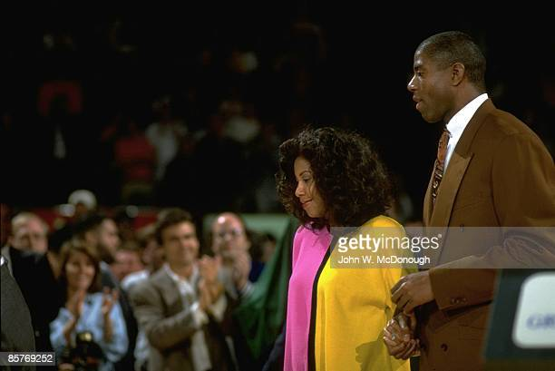 Former Los Angeles Lakers player Magic Johnson with wife Cookie during ceremony to retire his jersey number at Great Western Forum Inglewood CA...