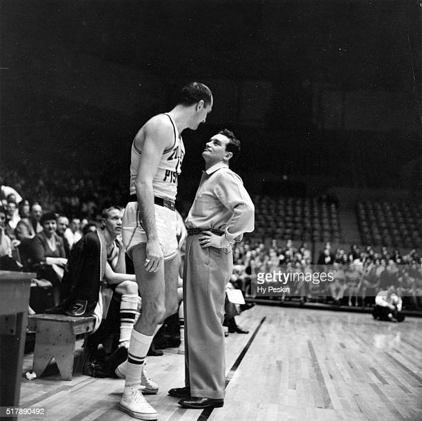 Fort Wayne Pistons head coach Charley Eckman with player during game vs Boston Celtics at War Memorial Coliseum Fort Wayne IN CREDIT Hy Peskin