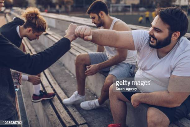 basketball friends relaxing - chubby men stock photos and pictures