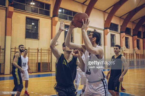 basketball game in motion - basketball competition stock pictures, royalty-free photos & images