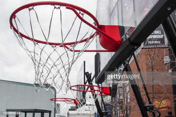 Basketball goals apart of the Big 12 fan experience await to be broken down due to the cancellation of the Big 12 Tournament to prevent the spread of...
