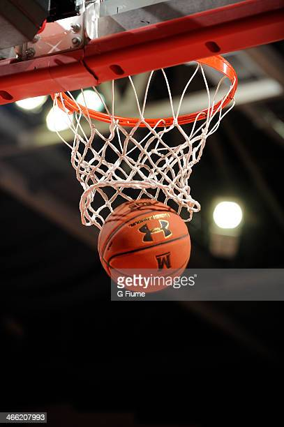 A basketball goes through the hoop during the game between the Maryland Terrapins and the Delaware State Hornets at the Comcast Center on December 14...