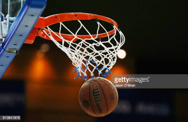 A basketball goes through the hoop during the round 16 NBL match between the Brisbane Bullets and the Adelaide 36ers at Brisbane Convention...