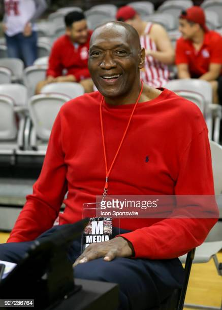 Basketball Hall of Fame member and radio analyst Elvin Hayes prepares for the men's basketball game between the UConn Huskies and Houston Cougars on...