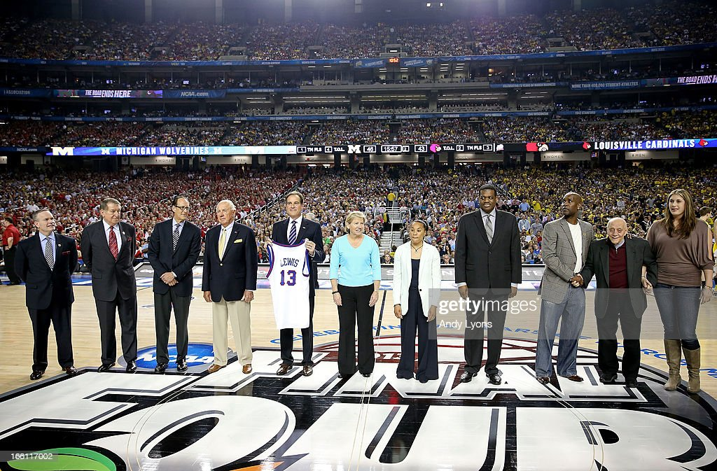Basketball Hall of Fame President & CEO John Doleva, Jerry Colangelo, Russ Granik, Richard Guerin, Jim Nantz (holding a Jersey representing Guy Lewis), Sylvia Hatchell, Dawn Staley, Bernard King, Gary Payton and Jerry Tarkanian stand on the court as the Naismith Memorial Basketball Hall of Fame 2013 Class On Court Announcement is made during the 2013 NCAA Men's Final Four Championship between the Michigan Wolverines and the Louisville Cardinals at the Georgia Dome on April 8, 2013 in Atlanta, Georgia.