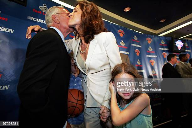 Basketball Hall of Famer Larry Brown kisses wife Shelly, who's flanked by their 11-year-old son, L.J. , and daughter Madison as Brown is formally...