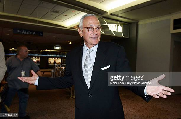 Basketball Hall of Famer Larry Brown shrugs as he speaks with reporters in the Theater at Madison Square Garden where he was formally introduced as...