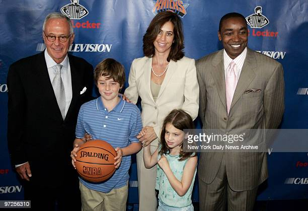 Basketball Hall of Famer Larry Brown wife Shelly and New York Knicks' president Isiah Thomas stand with Brown's children son LJ and daughter Madison...