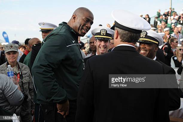 Basketball halloffamer and Michigan State Spartans alum Earvin 'Magic' Johnson talks with members of the United States Armed Forces before the North...