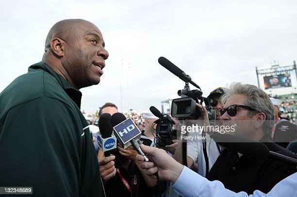 Basketball halloffamer and Michigan State Spartans alum Earvin 'Magic' Johnson talks with members of the media before the North Carolina Tar Heels...