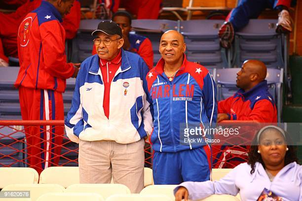 Harlem Globetrotters legends Tex Harrison and Curly Neal in stands before game vs Washington Generals at 369th Harlem Armory New York NY 10/5/2009...