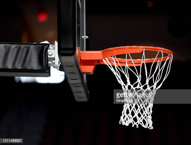 Basketball hoop and net are shown before a semifinal game of the West Coast Conference basketball tournament between the San Francisco Dons and the...