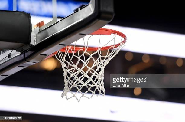 A basketball hoop and net are shown during a game between the Kentucky Wildcats and the Utah Utes during the annual Neon Hoops Showcase benefiting...