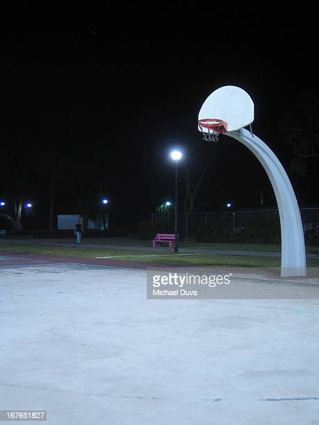 basketball hoop and net at night in park