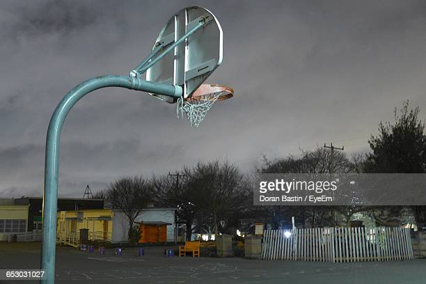 Basketball Hoop At Court During Dusk