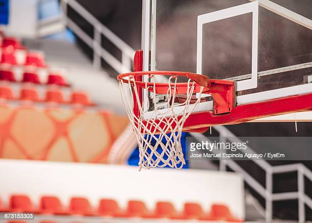 basketball hoop at court - basketball stadium stock photos and pictures