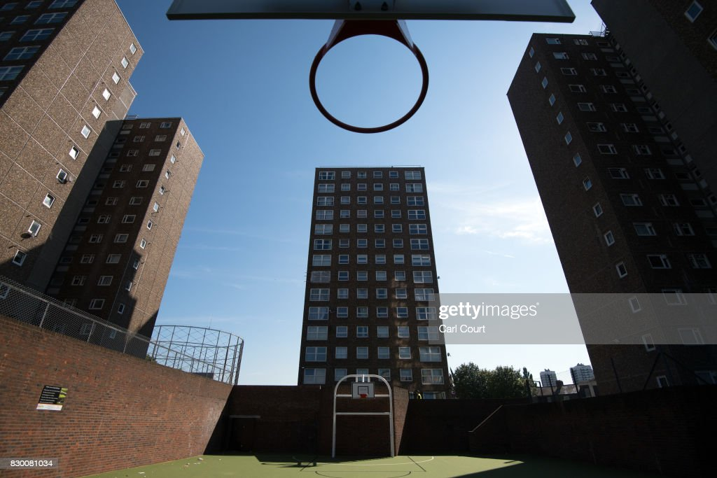 A basketball hoop hangs over a sports pitch on the Ledbury Estate on August 11, 2017 in London, England. Hundreds of residents of the estate are to be evacuated from four tower blocks over safety fears after a survey, ordered after the Grenfell Tower fire, found cracks in the walls leaving it vulnerable to collapse in the event of a gas explosion.
