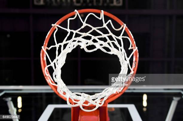 A basketball hoop net and backboard are shown before a semifinal game of the West Coast Conference Basketball Tournament between the Santa Clara...