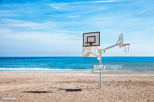 basketball hoop on a deserted beach - castellon de la plana stock photos and pictures