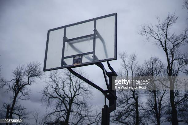 Basketball hoops and rims have been removed from the backboards to encourage social distancing and reduce coronavirus risk at Delaware Park in...