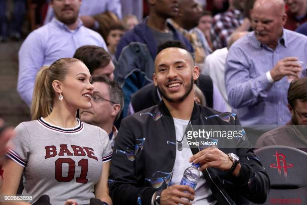 Houston Astros Carlos Correa with fiancee Daniella Rodriguez sitting courtside during Houston Rockets vs Golden State Warriors game at Toyota Center...