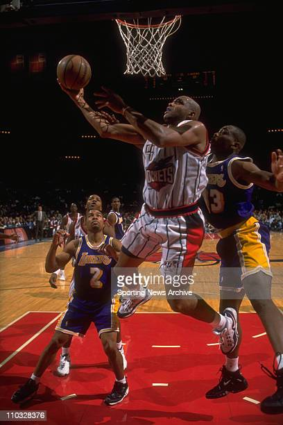 NBA Basketball Houston Rockets Charles Barkley and Los Angeles Lakers Derek Fisher and Corie Blount during a Nov 14 1997 game at The Summit in Houston