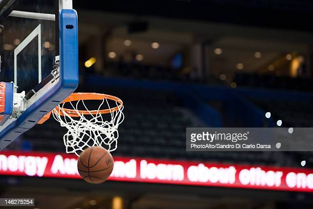 basketball in hoop, blurred motion - basket stock photos and pictures