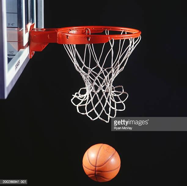 Basketball in hoop, close-up