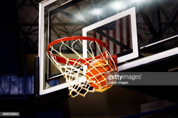 basketball in hoop - basketball hoop stock pictures, royalty-free photos & images