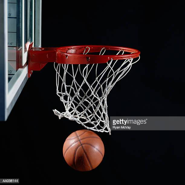 basketball in hoop - shooting baskets stock photos and pictures