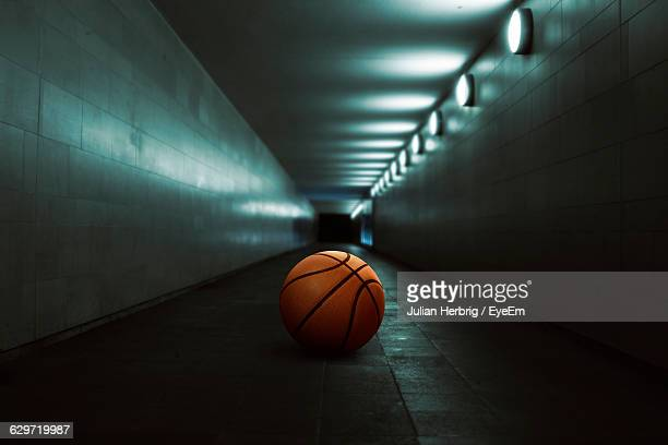 basketball in illuminated tunnel - tunnel stock pictures, royalty-free photos & images