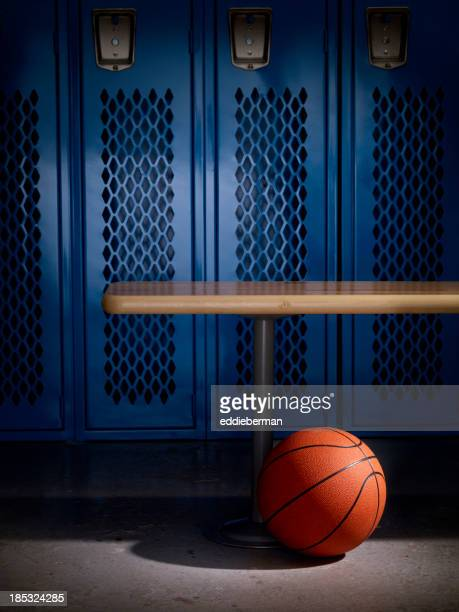 basketball in locker room - march madness basketball stock photos and pictures