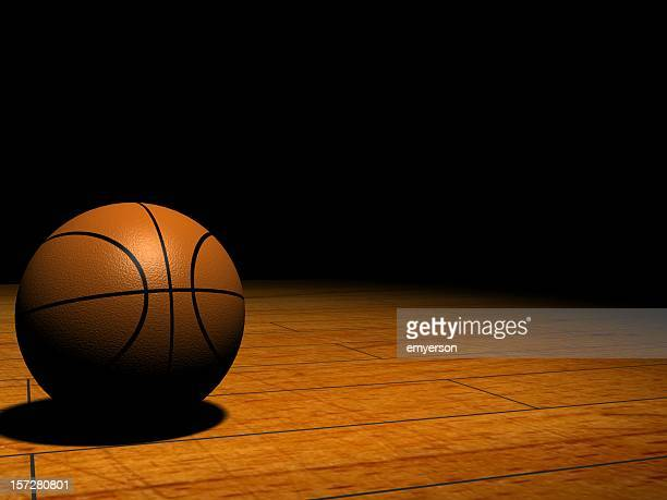 basketball in the spotlight - march madness basketball stock photos and pictures