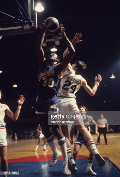 Indiana Pacers George McGinnis in action vs Denver Nuggets Bobby Jones during game at Denver Auditorium Arena Denver CO CREDIT Heinz Kluetmeier