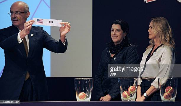 Basketball International Federation Sports Director and former basketball player Lubomir Kotleba shows the paper of the USA after it was drawn by...